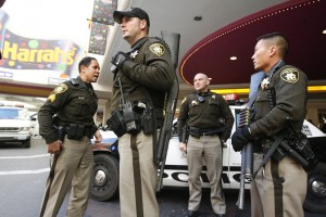Las Vegas police stand guard outside the Harrah's hotel-casino in Las Vegas on Feb. 21, 2006. As officer Norman Jahn recalls, police arrested the suspected gunman without firing a shot.