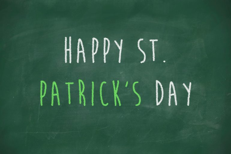 Happy st patricks day handwritten on school blackboard