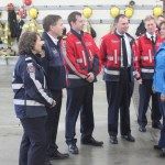 Members of Coquitlam Fire Rescue speak with the Premier