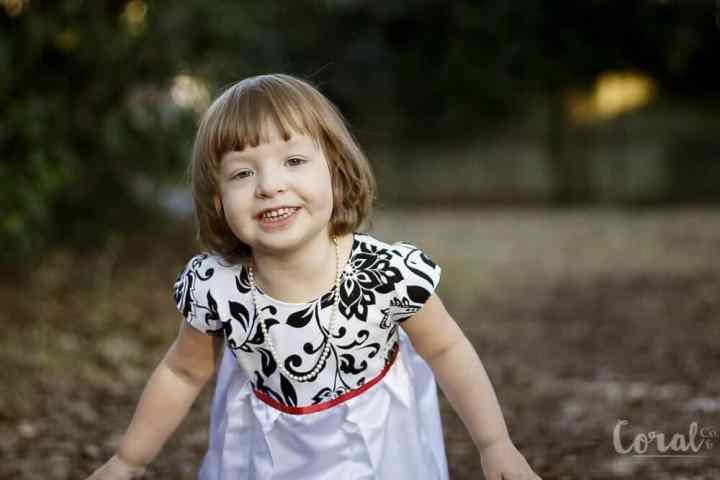 little-girl-smiling-deranium-dress