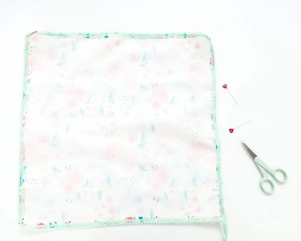 diy-pom-pom-napkin-tutorial-with-mitered-corners