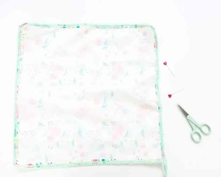 diy-pom-pom-napkin-tutorial-with-mitered-corners