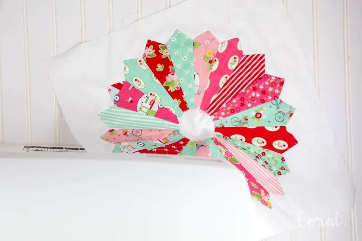 center-dresden-plate-quilt-block-on-pillow-front