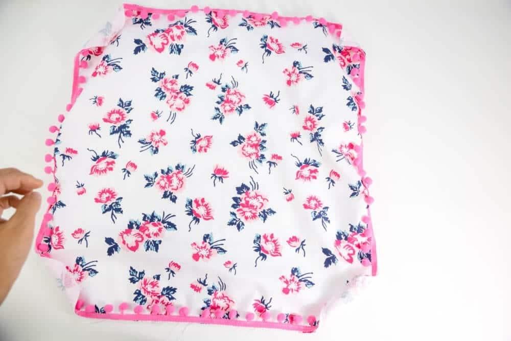 add-pom-pom-trim-to-edges-of-pillow-front