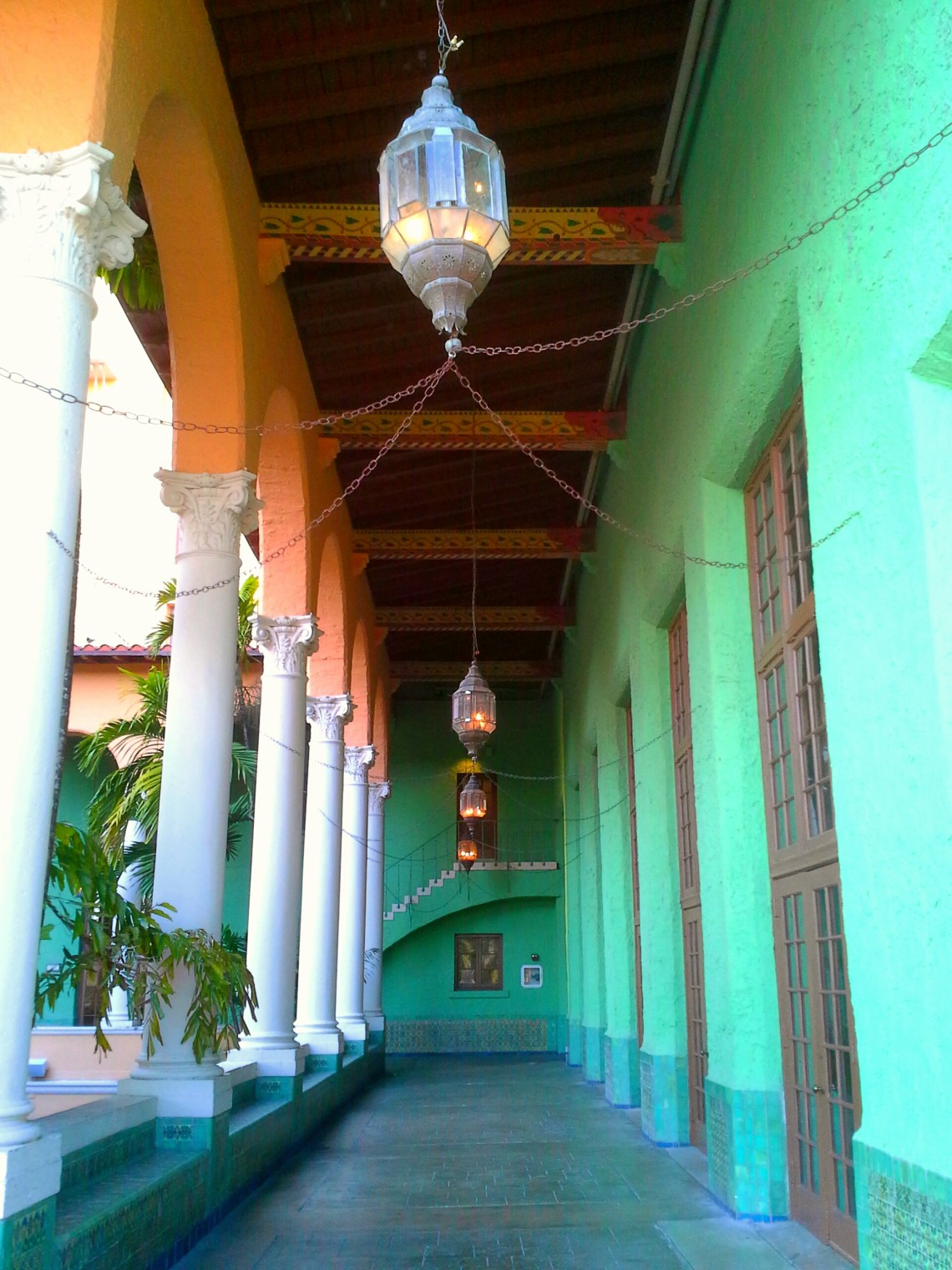 The Biltmore Hotel has an upper courtyard with a long corridor with bright green walls. This is a famous spot for engagement photos in South Florida.
