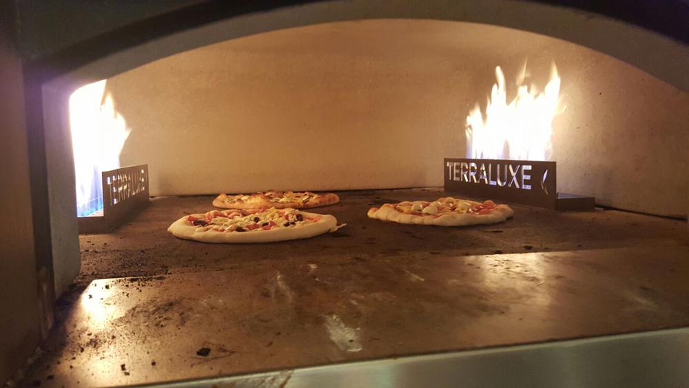 Cibo Wine Pizza Class pizza in the oven.