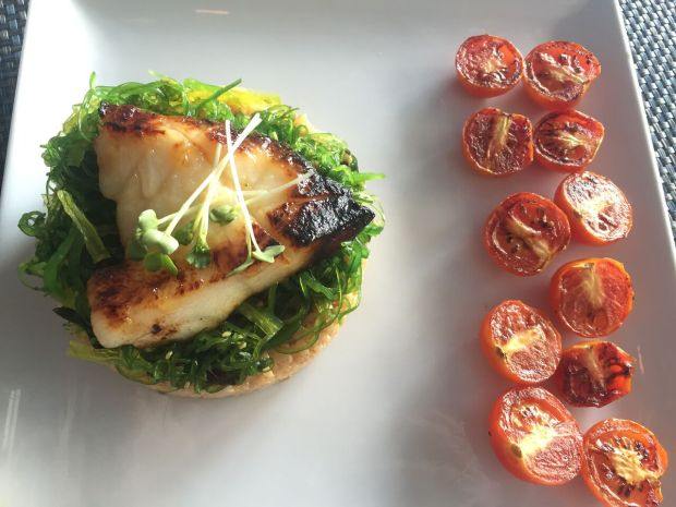 Miso Yaki Seabass with roasted tomatoes from Sushi Maki in Coral Gables. Click to read more or Pin and save for later.