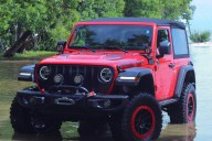 Jeep Wrangler Rubicon Exploring High Tide in Matheson Hammock Park in Coral Gables, Florida - Miami