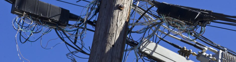 Telephone Terminals in Disarray on Phone Pole
