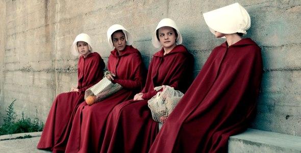 4 woman sitting on bench handmaids tale