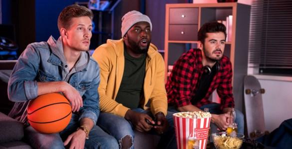 3 men watching sports on tv