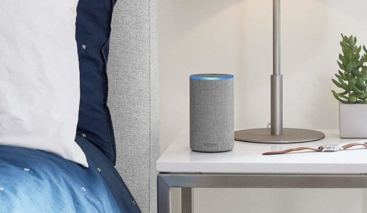 amazon echo on table next to bed