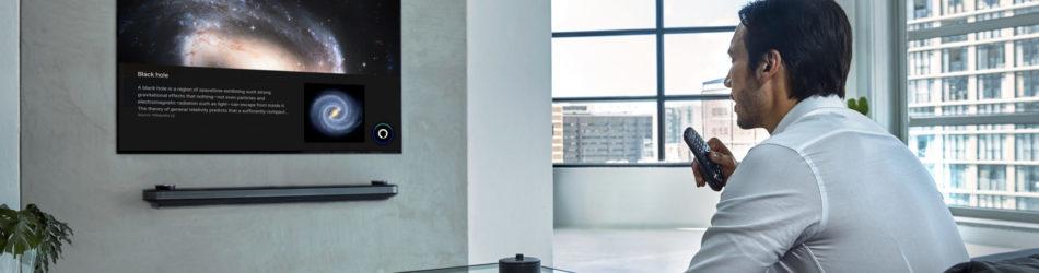 man watching lg tv with amazon alexa