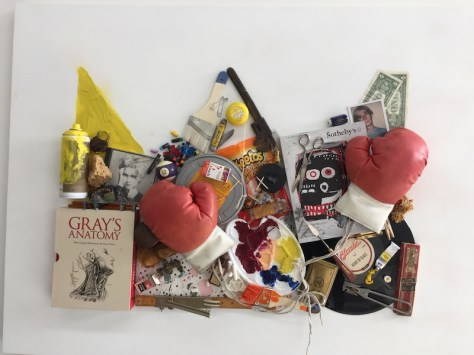 Boxing gloves and other objects glued to a panel form the shape of a crown