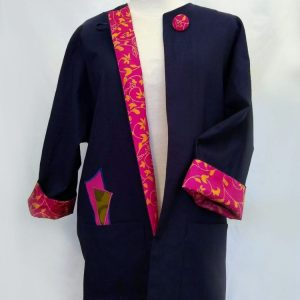Navy blue linen jacket with facings and appliqués made from recycled fabric