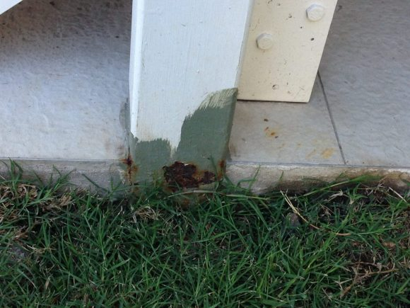 Photos of a steel post that has corroded