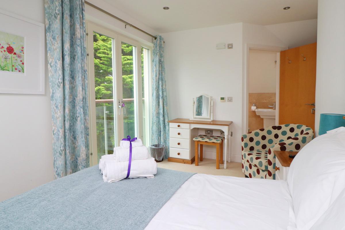 Doyden double bedroom with patio door