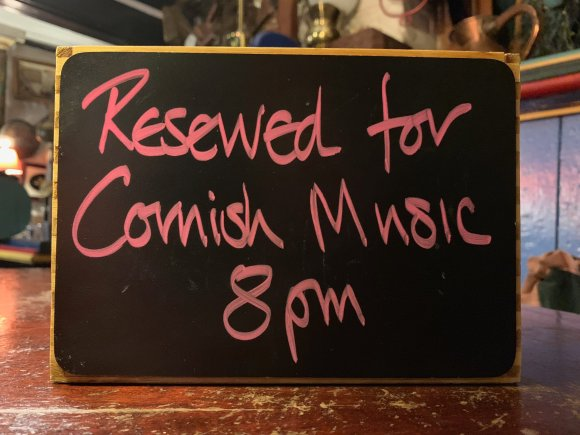 """Small blackboard sign reading """"Reserved for Cornish Music 8pm"""""""
