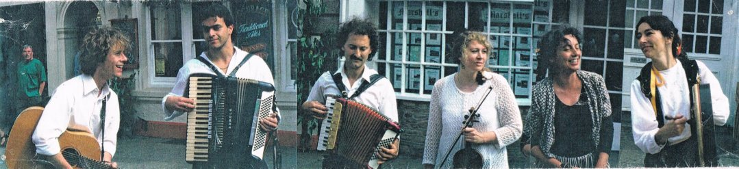Five members of a band holding different instruments, guitar, accordions, violin, clarinet