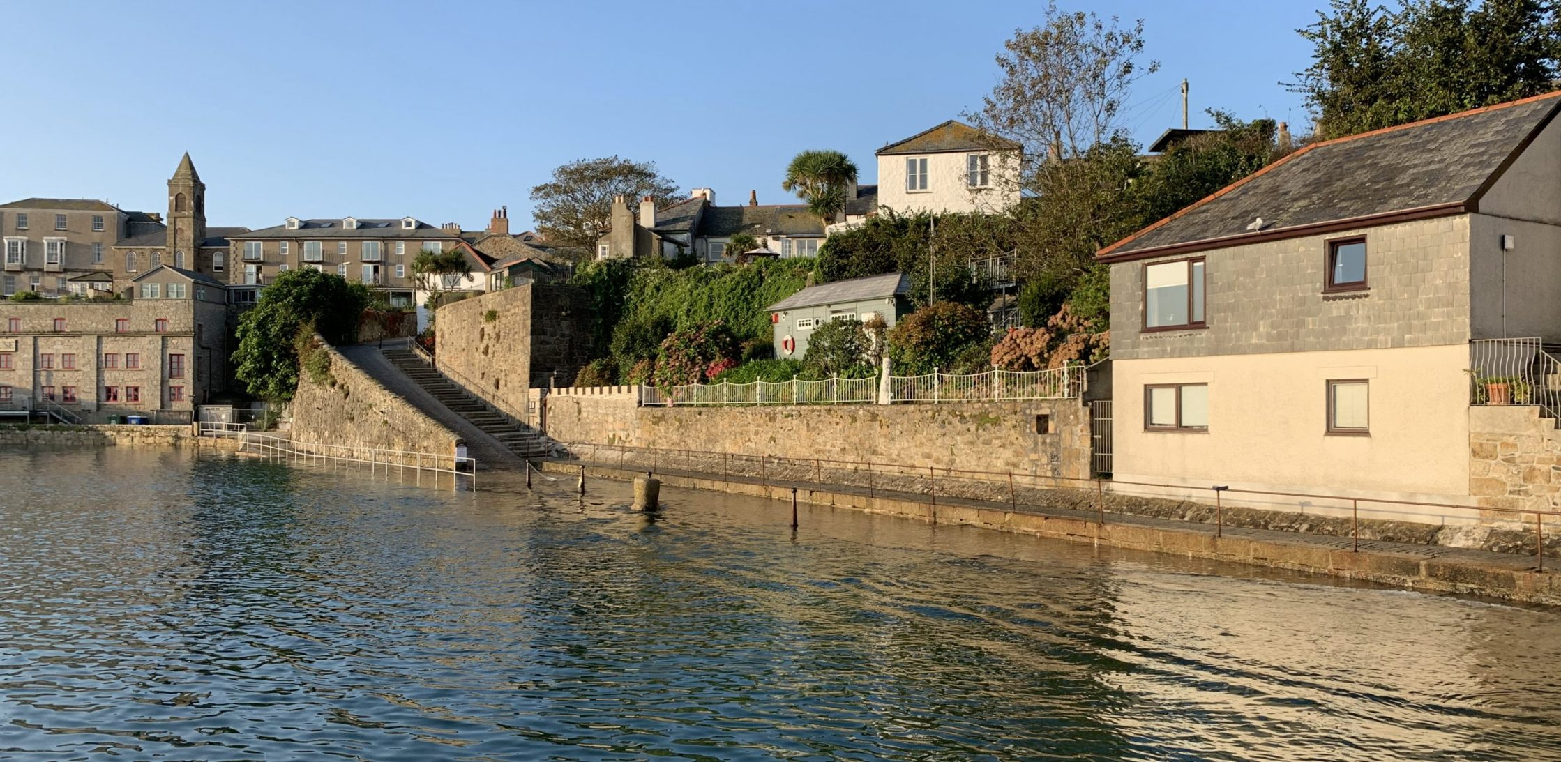 Abbey Slip, Penzance, with the wharf flooded at high tide.