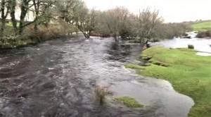 De Lank River in flood bursting its banks in December 2020