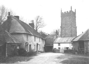 A winter view of the Church tower, lychgate and cottages. Photographer: Arthur William Jordan.