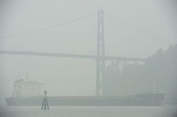 Thick smoke fills the air around a ship.