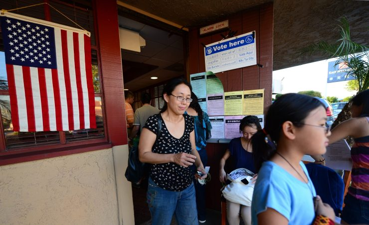 Asian Americans leave a polling palce