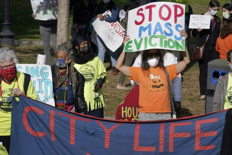 Protesters display placards during a demonstration to support for tenants and homeowners at risk of eviction in Boston on Oct. 11.