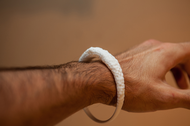 Officina-Corpuscoli-Infected-Jewellery-white-bracelet-on-hand