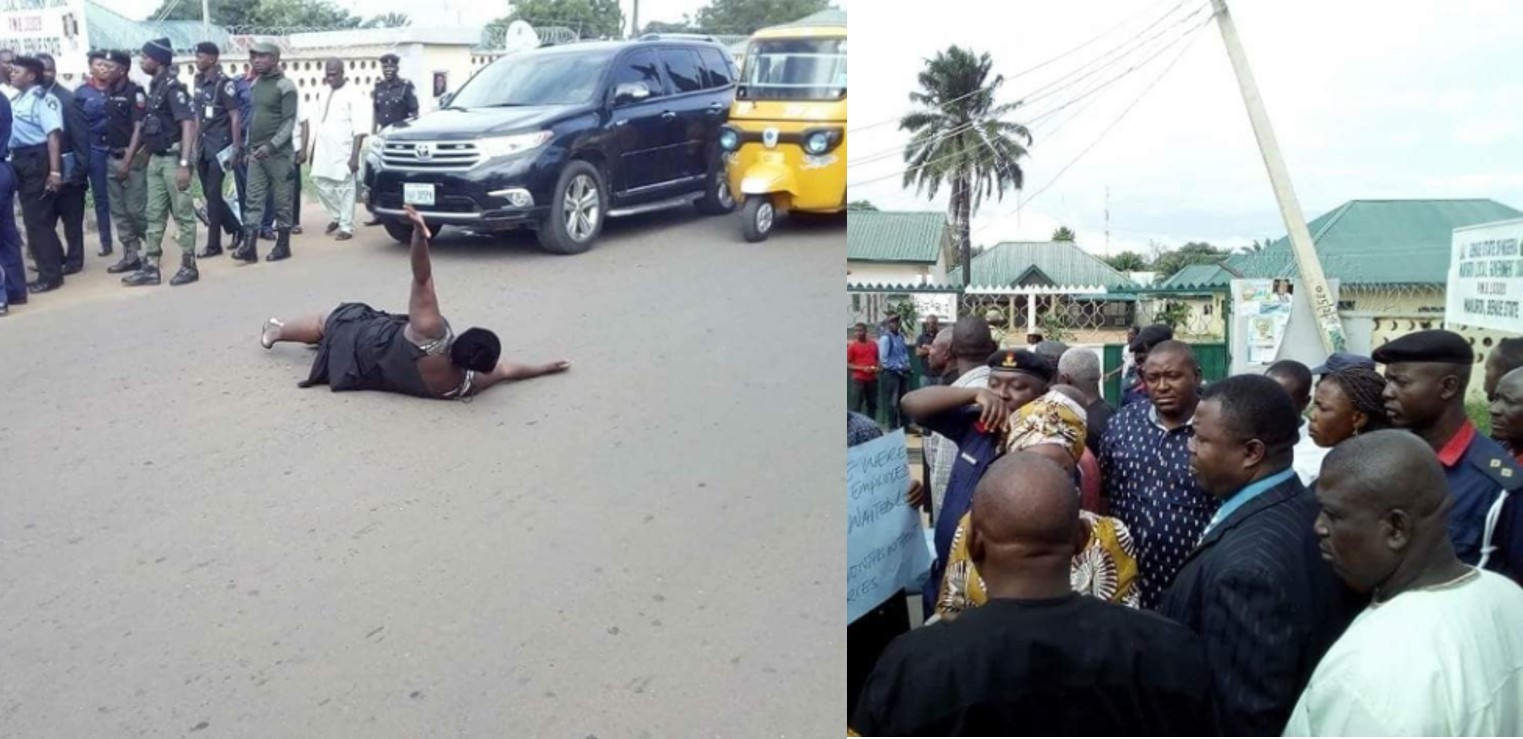 Nigeria woman lays in the middle of a busy road to protest over 13 months unpaid salary