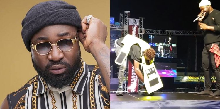 Harrysong gifts fan sneakers, belt, jacket on stage and promises to change his life (Video)