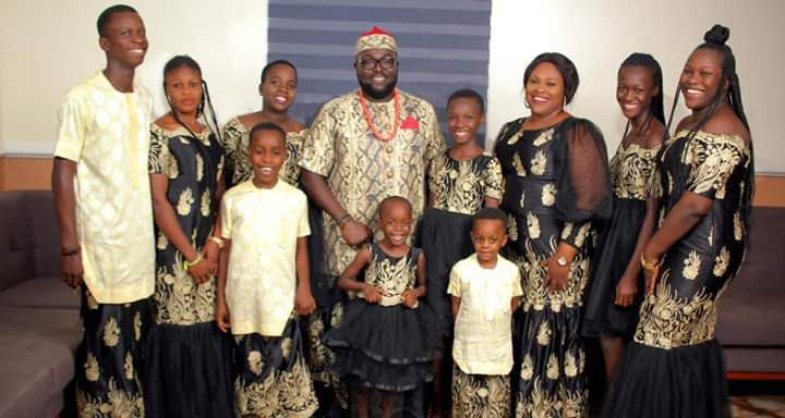 Akwa Ibom man shares 16th wedding anniversary photo with his wife, biological children, adopted kids and housemaid