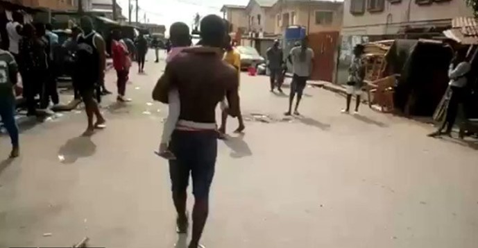 Lagos residents hit the streets to protest as hunger strikes hard amid lockdown (Video)