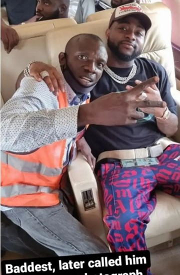 Davido invites airport official into his jet after he was pushed by bodyguard while trying to take selfie with the singer