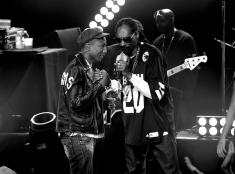BURBANK, CA - MAY 11: (EDITORS NOTE: This image was processed using digital filters.) Producer/Recording artist Pharrell Williams (L) and rapper Snoop Dogg perform onstage during Snoop Dogg Live on the Honda Stage at iHeartRadio Theater on May 11, 2015 in Burbank, California. (Photo by Kevin Winter/Getty Images for iHeartMedia)