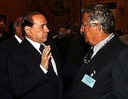 Silvio Berlusconi e Carlo De Benedetti (Imagoeconomica)