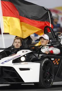 Gp di Malesia, trionfo Ferrari. E Vettel salta sul podio come Schumacher