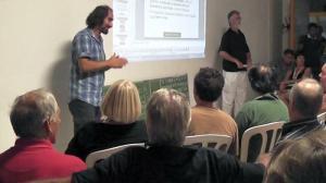 Parodi, a sinistra, ad un convegno