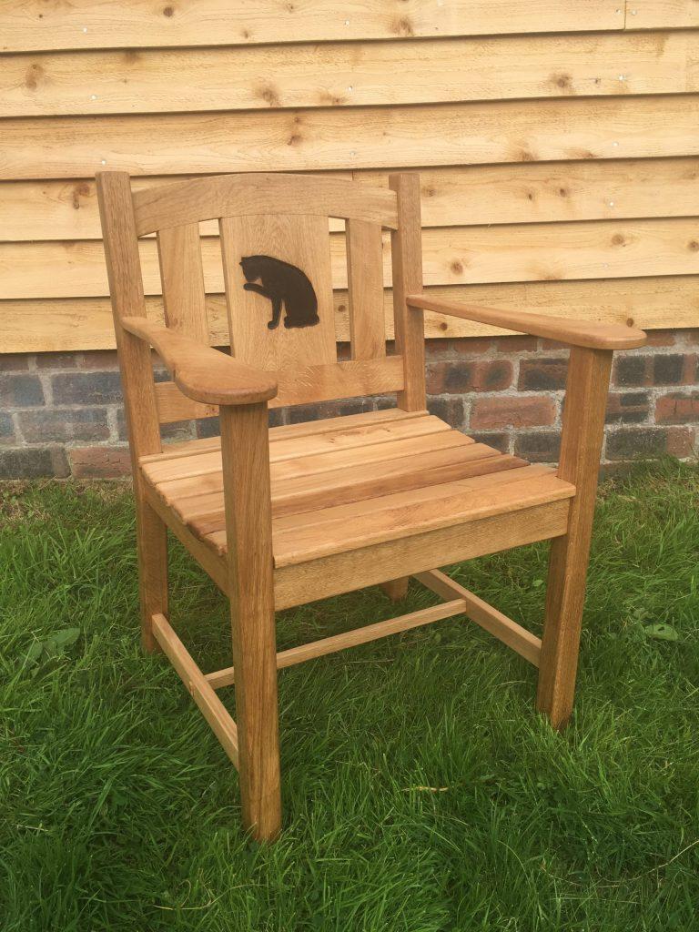 Oak garden chair for a cat lover