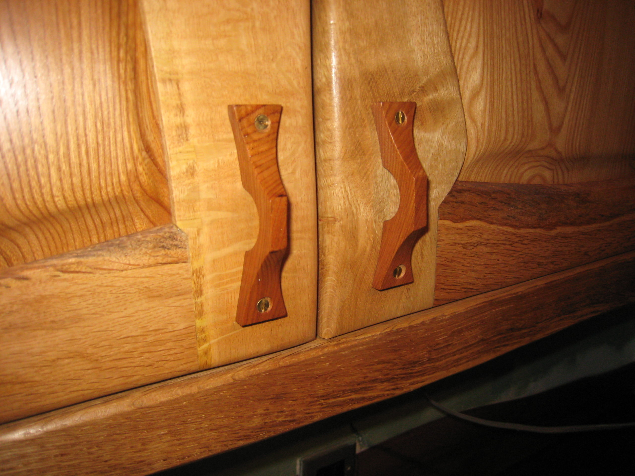 Handle detail on an oak and elm kitchen