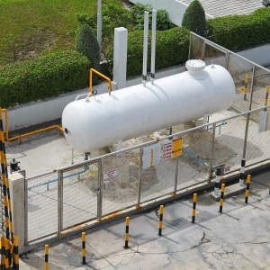 Liquid Petroleum Gas (LPG) storage unit inside a fence to prevent dangerous unauthorized intervention. Concept of Oil and Gas structure.