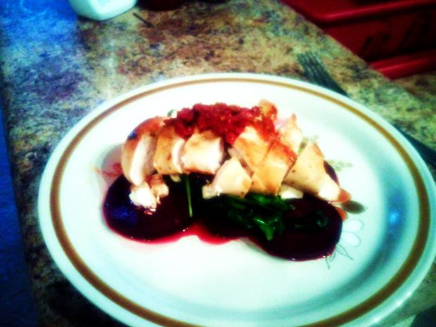 Broiled Chicken breast Served over Oven Roasted Beats toped with feta cheese and lite drizzle of balsamic and sauted garlic spinach