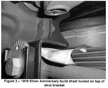 Figure 3: 1978 Corvette Silver Anniversary build sheet tucked on top of a strut bracket.