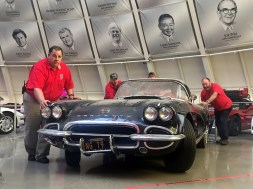"The 1962 ""sinkhole"" Corvette being moved from display in the Skydome to a Museum garage bay where it will undergo restoration."