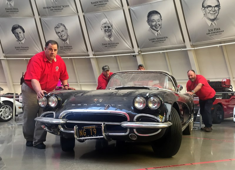 """The 1962 """"sinkhole"""" Corvette being moved from display in the Skydome to a Museum garage bay where it will undergo restoration."""