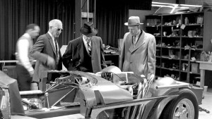 The late Zora Arkus-Duntov, on the left in sunglasses, shows executives the assembly of one of five 1963 Chevrolet Corvette Grand Sport racecars.