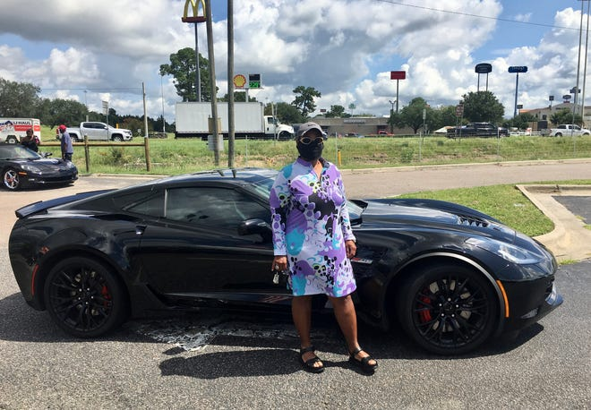 Vanessa Bishop Diggs, 66, stands with her 2019 Chevrolet Corvette Z06 on Aug. 15, 2020.