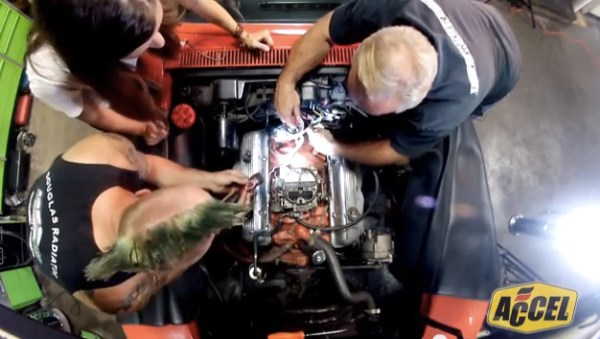 ACCEL's Jenny Long, vehicle caretaker Steve Hanzi, and mechanic Timmy Hinkle of Little Green Customs install an ACCEL recipe for performance '68 Corvette
