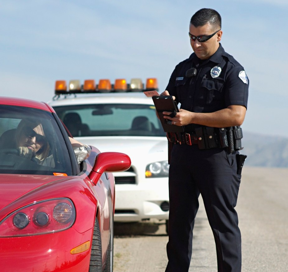 Corvette and Police Officer
